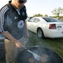 Tom Works The Grill